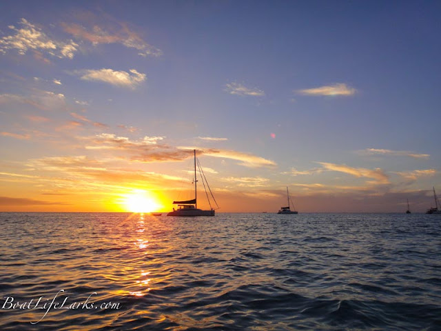 Sunset with sailboats at anchor in West Bay, New Providence Island