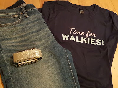 The Time for walkies tee laid out with a pair of jeans and a belt