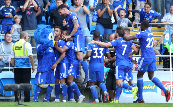 Victor Camarasa of Cardiff City celebrates with team mates after he scores his sides first goal during the Premier League match between Cardiff City and Arsenal FC at Cardiff City Stadium on September 2, 2018 in Cardiff, United Kingdom.