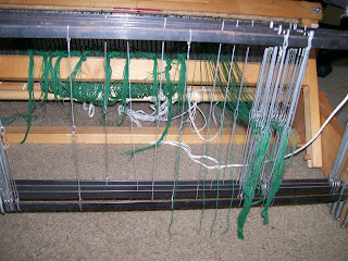 Warp threaded through heddles.