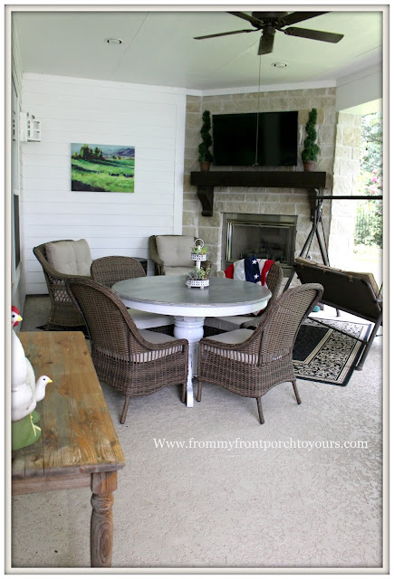 covered back porch-wicker furniture-round dining table-outdoor furniture-outdoor fireplace- from my front porch to yours