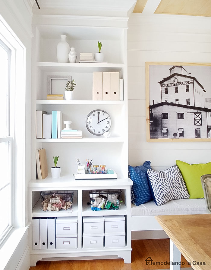 kea storage boxes, big clock and wire baskets on built-ins