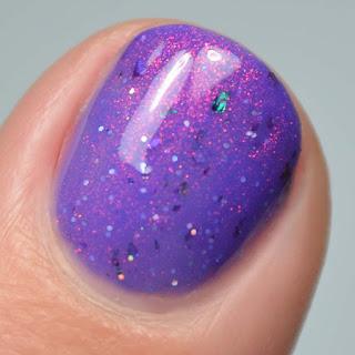 purple shimmer nail polish macro