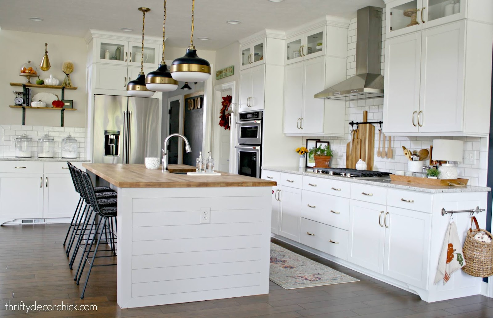 Light gray island with butcher block counters