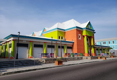Brightly colored straw market building