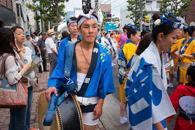 Man carrying drum at the 60th Koenji Awa-Odori Festival, Suginami ward, Tokyo, Japan.