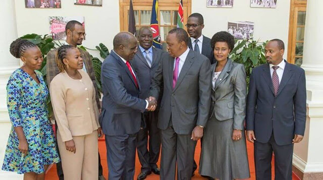 President Uhuru Kenyatta with IEBC commissioners at statehouse