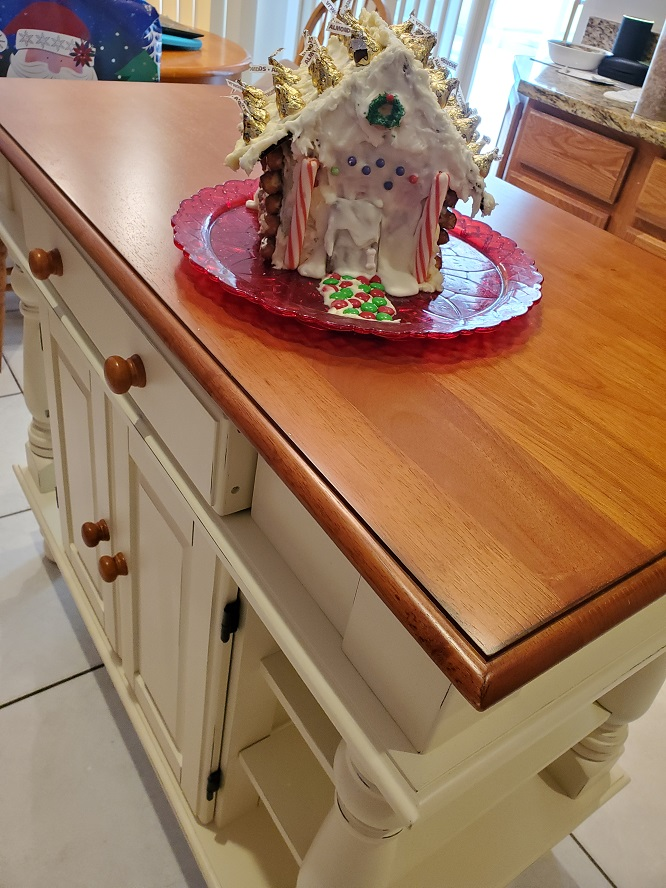 this is a kitchen island with a decorated Christmas candy house on top and the directions how to make it