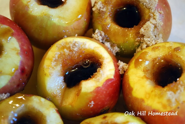 Fill the middle of the apples with brown sugar and a little water.