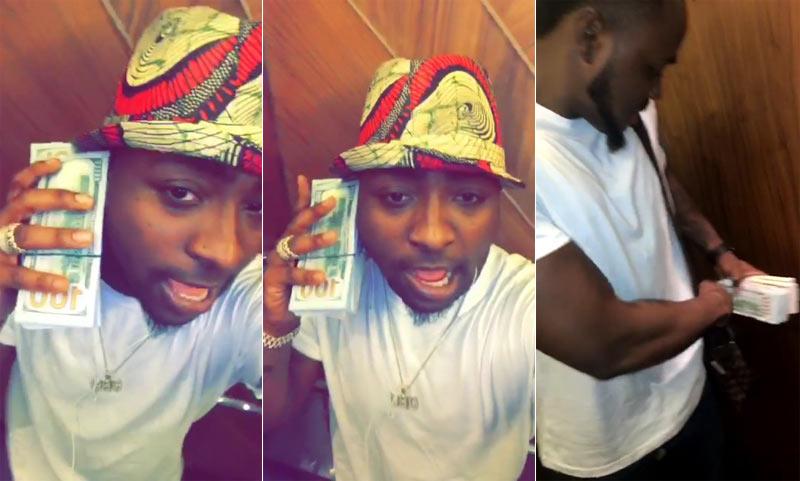 Davido flaunts wads of cash he made in Gabon