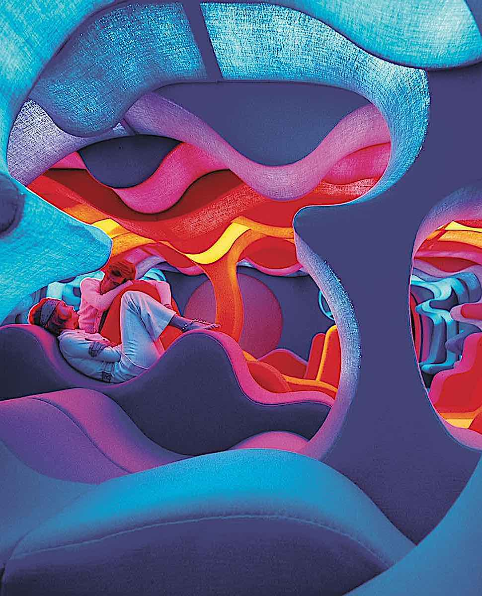 a 1970 Verner Panton red yellow blue interior with a modern couple, color photograph