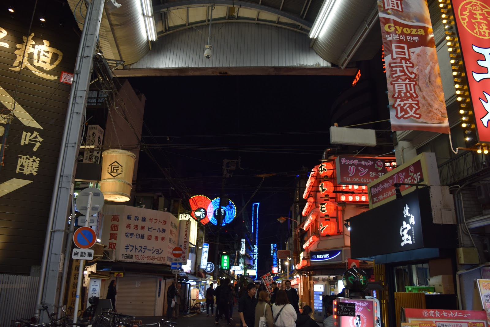 neon lights and lanterns in Osaka at night