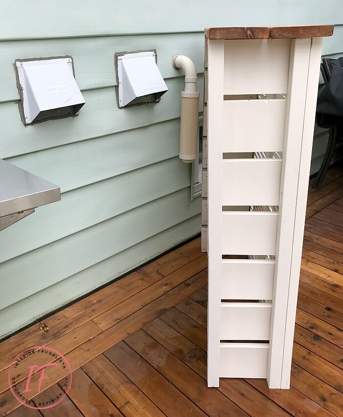 How to hide unsightly outdoor house vents with repurposed wooden louvered bifold doors into a DIY outdoor bar table plus BBQ grilling utensil holder.