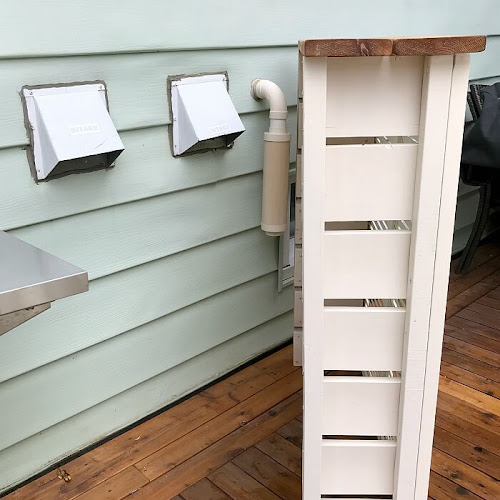How To Hide Unsightly Outdoor Vents With Repurposed Doors