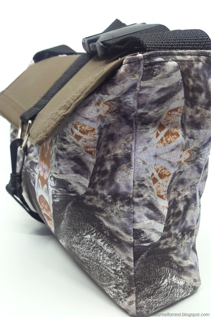 combining old and new fabric to handmake a new carry bag