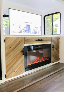 Mountain Modern Life makes good use of their RV space with a Touchstone TV Lift and electric fireplace.