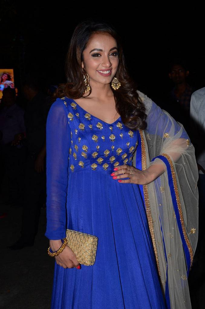 Actress Tejaswi Stills In Blue Dress At Audio Launch