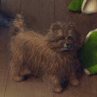 Black lap dog depicted in flemish painter Jan van Eyck's Arnolfini Portrait, symbolizes fidelity and lust between Arnolfinis