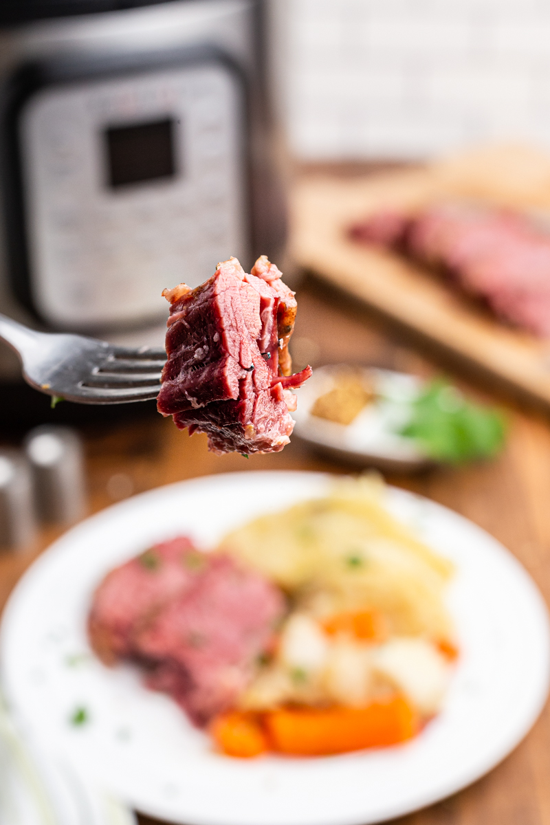 Close up photo of a bite of Keto Corned Beef on a fork.