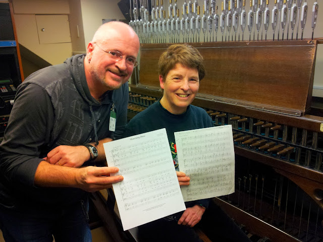 Pierre Massie and Dominion Carillonneur, Andrea McCrady pose with his Composition, Mourning Dove