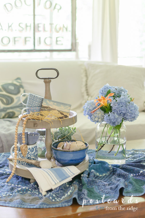 blue and white decor with hydrangeas in a vintage mason jar