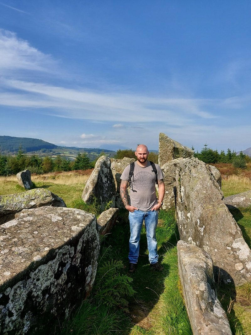 Gordon, looking small, among the Giants Graves