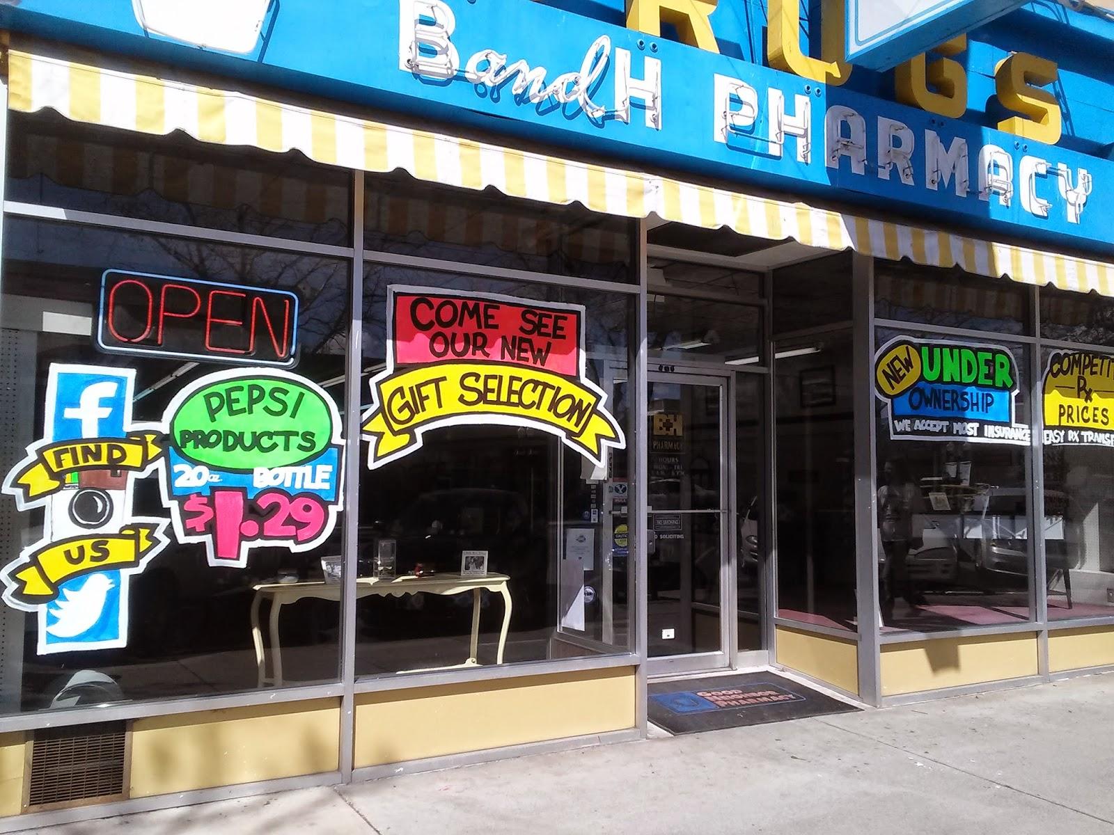 Whimsical Window Painting: B&H Pharmacy Spring Window