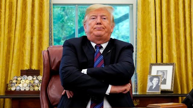 President Trump, sitting like a petulant child