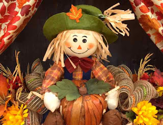 Halloween small scarecrow with halloween decorations