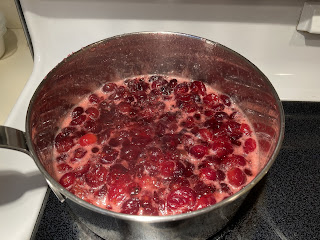 Cranberries boiling in a pot of water