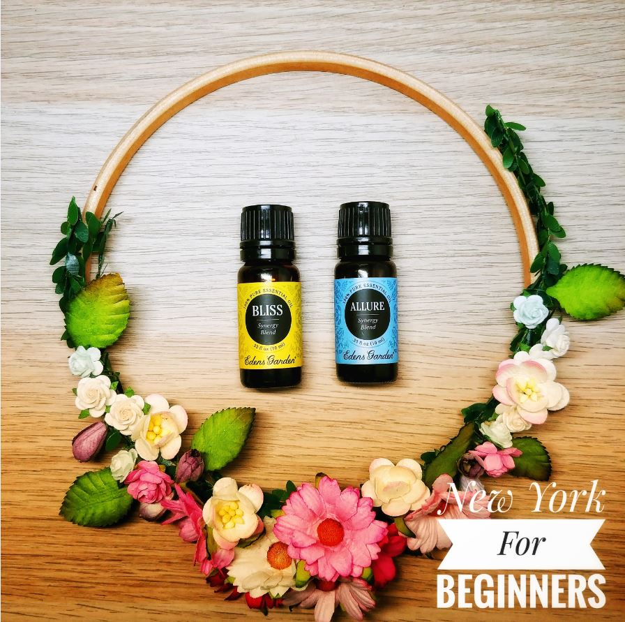 Two edens garden essential oil blends inside a circle of flowers