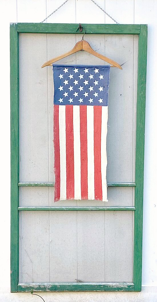 Vintage hanger with DIY Vertical American flag on a green screen door