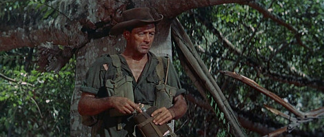 William Holden in army uniform in the jungle