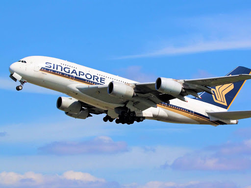 'AIRPORT SONG' BY MAGNA CARTA - REFERS TO A FLIGHT TO SINGAPORE IN THE 60's.