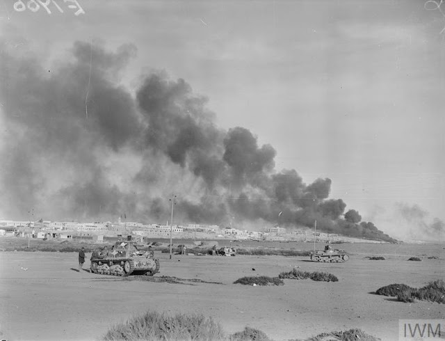 24 January 1941 worldwartwo.filminspector.com Tobruk burning captured Italian tanks