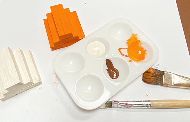 pallet with orange painted blocks