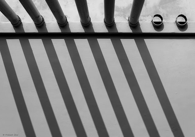 "A Looking Up Black and White Minimalist ""Photograph of Two Missing Pipes from a Pipe Arrangement."