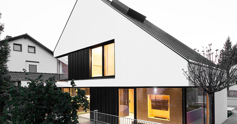 Casa con due piani integrati nel tetto spiovente by Format ...