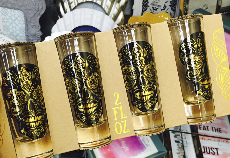 shot glasses with dia de los muertos in them