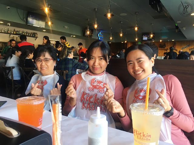 three ladies eating at seafood restaurant