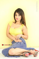 Cute Telugu Actress Shunaya Solanki High Definition Spicy Pos in Yellow Top and Skirt  0272.JPG