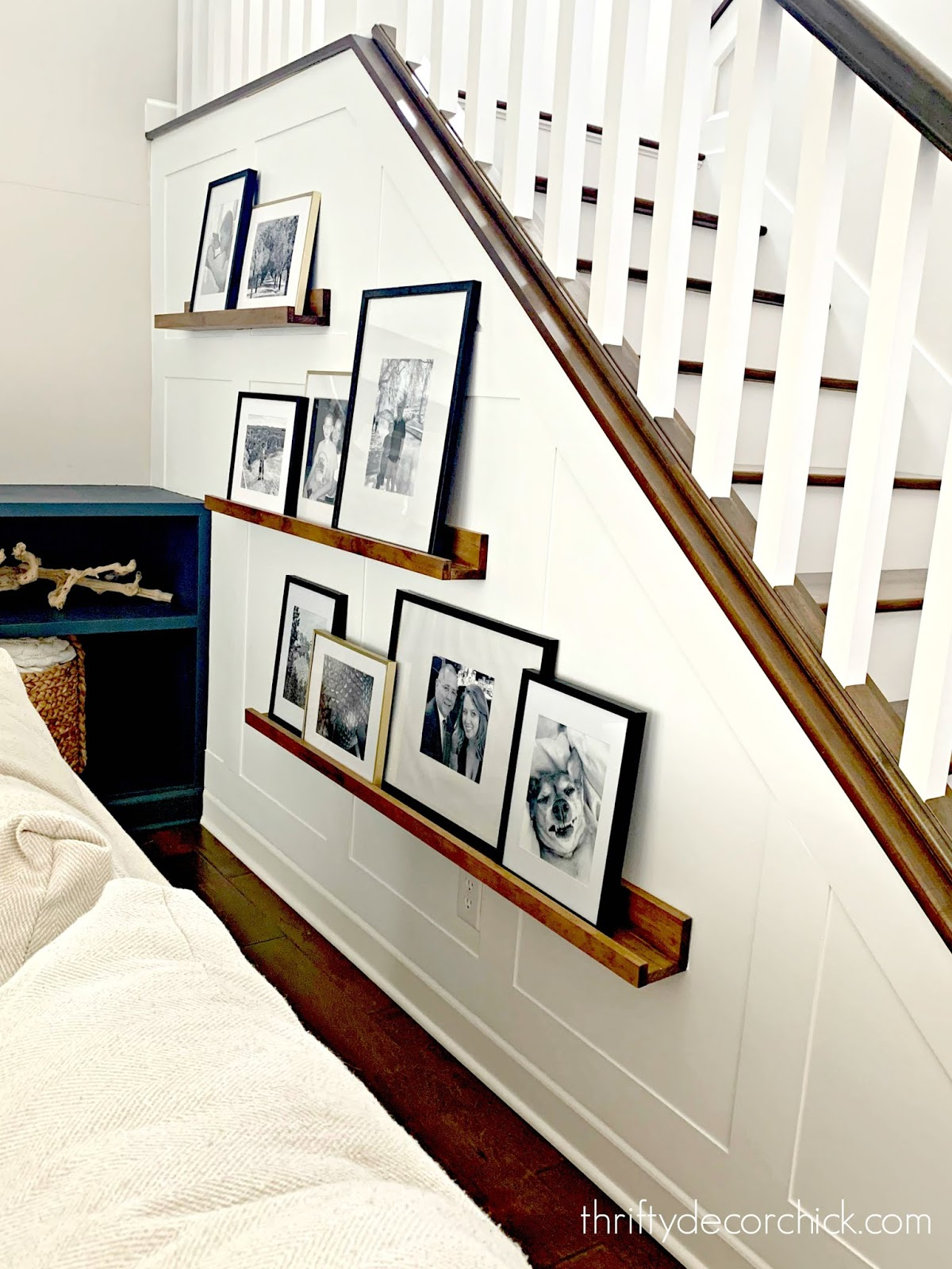 White accent board and batten wall stairs