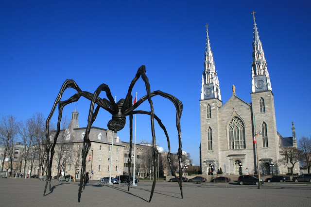 Maman, the National Gallery of Canada's famous spider stares at the Cathedral across the street