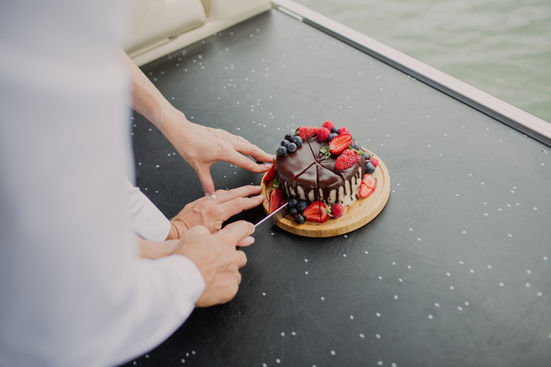cutting the cake on the boat