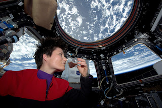 Cristoforetti, in the 'cupola' of the Space Station,  savours the first espresso brewed in space