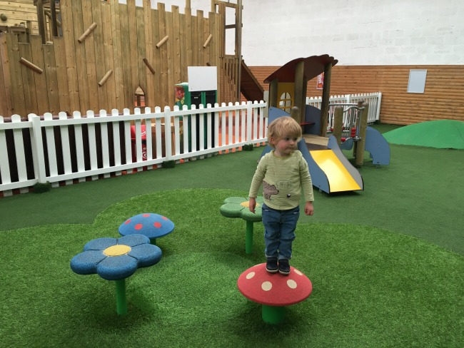 parc-play-cardiff-toddler-on-mushroom-play-equipment