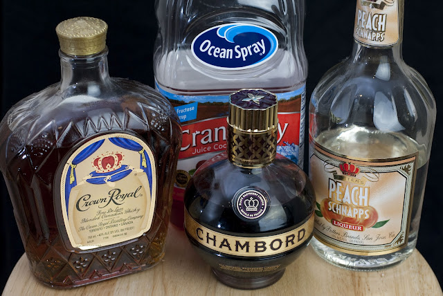Royal flush cocktail, poker, crown royal, peach schnapps, chambord, cranberry juice, black raspberry liqueur