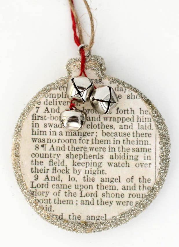 The birth of Christ scripture copy made into an ornament with added glitter