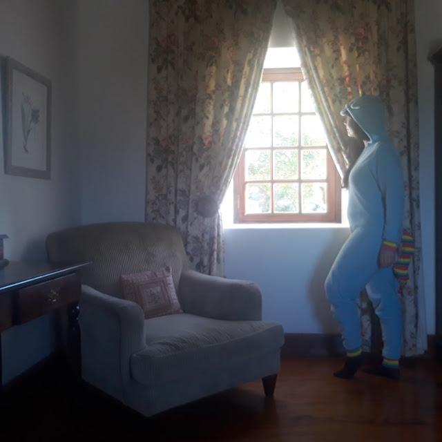 Girl in unicorn onesie