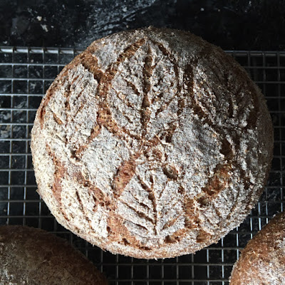 Bread scored with a leaf design
